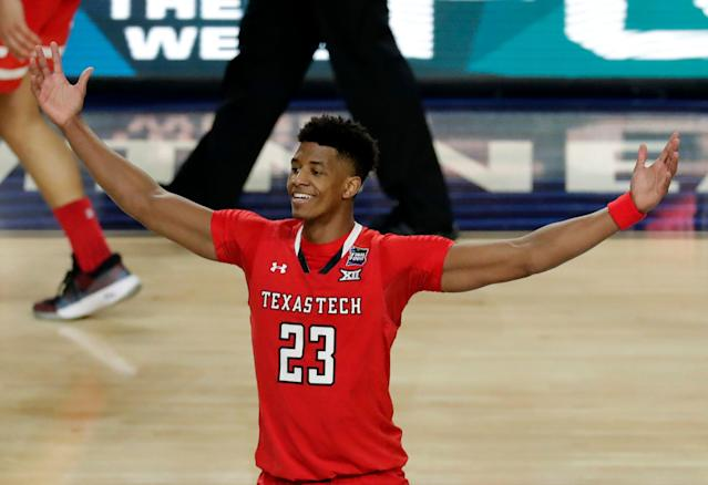 "Texas Tech's <a class=""link rapid-noclick-resp"" href=""/ncaab/players/142322/"" data-ylk=""slk:Jarrett Culver"">Jarrett Culver</a> (23) celebrates after defeating Michigan State 61-51 in the second half in the semifinals of the Final Four NCAA college basketball tournament, Saturday, April 6, 2019, in Minneapolis. (AP Photo/Matt York)"