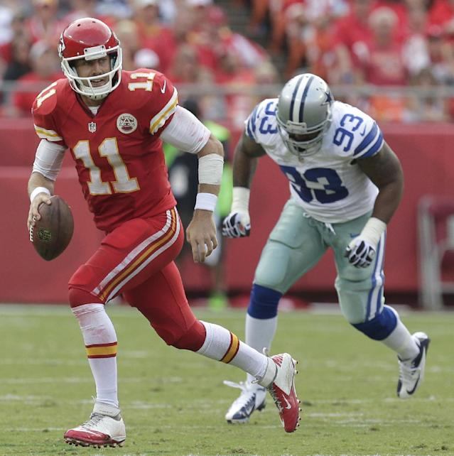 FILE - In this Sept. 15, 2013, file photo, Kansas City Chiefs quarterback Alex Smith (11) looks for a receiver as he is chased by Dallas Cowboys defensive end Anthony Spencer (93) during an NFL football game in Kansas City, Mo. Spencer might need microfracture surgery on his left knee and could miss the rest of the season. (AP Photo/Charlie Riedel, File)