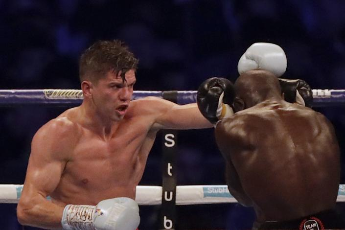 Luke Campbell throws a punch at Yvan Mendy during a fight at Wembley Stadium in London in September 2018.