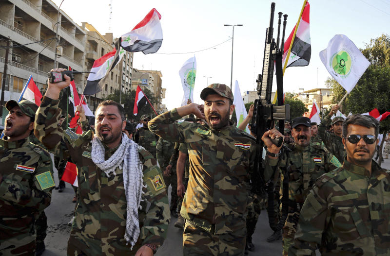 Iraqi Shiites from the Badr forces militia protest against the military intervention in Yemen, in Baghdad, Iraq in 2015. (Photo: Karim Kadim/AP)