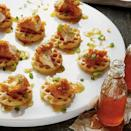 """<p><strong>Recipe: <a href=""""https://www.southernliving.com/syndication/buttermilk-chicken-waffles"""" rel=""""nofollow noopener"""" target=""""_blank"""" data-ylk=""""slk:Buttermilk Chicken and Waffles"""" class=""""link rapid-noclick-resp"""">Buttermilk Chicken and Waffles</a></strong></p> <p>Pick up fried chicken breast tenders from your favorite supermarket or restaurant to help these miniature chicken and waffles come together quickly. </p>"""
