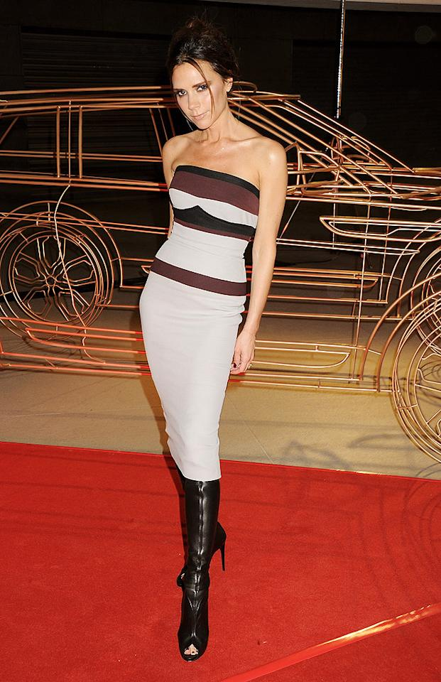 Naturally, Victoria Beckham wore one of her own dresses while in China for the unveiling of her special edition Range Rover Evoque. Many of you will likely leave a comment suggesting she eat a hamburger (or six!), but I think she looks sensational in this strapless, color-blocked frock and knee-high, peep-toe boots. Discuss! (4/22/2012)