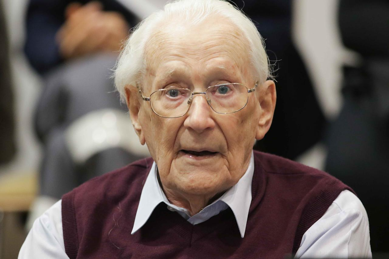 """Oskar Groening, defendant and former Nazi SS officer dubbed the """"bookkeeper of Auschwitz"""", sits in the courtroom during his trial in Lueneburg, Germany, July 15, 2015. The 94-year-old German man who worked as a bookkeeper at the Auschwitz death camp was convicted on Wednesday of being an accessory to the murder of 300,000 people and was sentenced to four years in prison, in what could be one of the last big Holocaust trials, Lueneburg, Germany, July 15, 2015. REUTERS/Axel Heimken/Pool"""