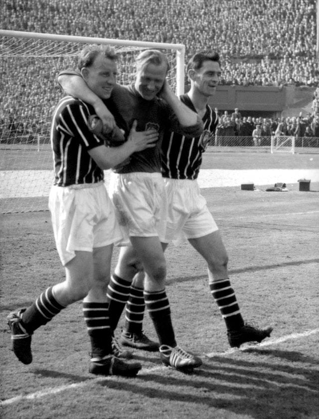 Trautmann (centre) became a City hero with his injury-defying performance in the 1956 FA Cup final