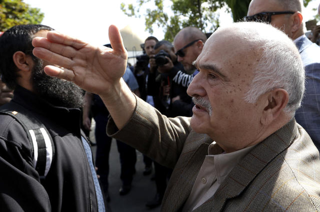His Royal Highness Prince El Hassan bin Talal Hashemite of the Kingdom of Jordan greets worshippers outside the Al Noor mosque in Christchurch, New Zealand, Saturday, March 23, 2019. The mosque reopened today following the March 15 mass shooting. (AP Photo/Mark Baker)