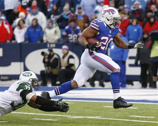 Buffalo Bills running back Tashard Choice (20) eludes New York Jets strong safety Yeremiah Bell (37) to run for a touchdown during the second half of an NFL football game on Sunday, Dec. 30, 2012, in Orchard Park, N.Y. Buffalo won, 28-9. (AP Photo/Bill Wippert)