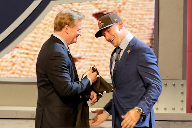 Johnny Manziel hugs NFL Commissioner Roger Goodell after being selected by the Cleveland Browns at the 2014 NFL Draft at Radio City on Thursday, May 8th, 2014 in New York, NY. (AP Photo/Gregory Payan)