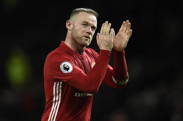 Manchester United's English striker Wayne Rooney reportedly declined an invitation to attend an England squad meeting because he was unhappy to have been dropped (AFP Photo/Oli SCARFF )
