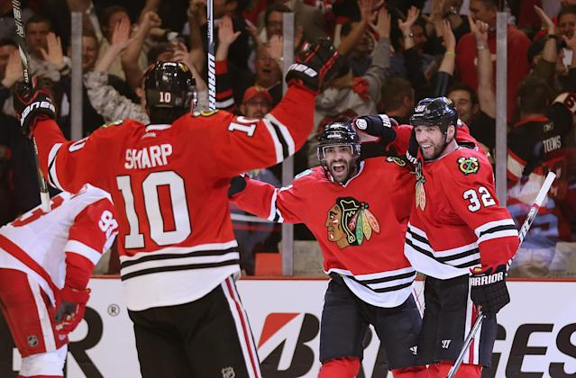 CHICAGO, IL - MAY 15: (L-R) Patrick Sharp #10, Johnny Oduya #27 and Michal Rozsival #32 of the Chicago Blackhawks celebrate Oduyas' third period goal against the Detroit Red Wings in Game One of the Western Conference Semifinals during the 2013 NHL Stanley Cup Playoffs at the United Center on May 15, 2013 in Chicago, Illinois. The Blackhawks defeated the Red Wings 4-1. (Photo by Jonathan Daniel/Getty Images)