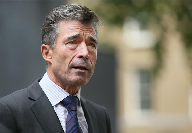 NATO Secretary General Anders Fogh Rasmussen speaks to the media after a meeting with Britain's Prime Minister David Cameron in 10 Downing Street in London, Wednesday, Sept. 18, 2013. Rasmussen said they discussed several topics including the situation in Syria. (AP Photo/Alastair Grant)