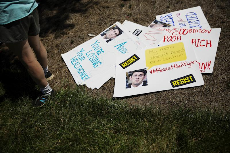 Signs lay on the ground during a protest against a scheduled visit by House Speaker Paul Ryan at a campaign event for Republican candidate for 6th congressional district Karen Handel in Dunwoody, Ga. on May 15, 2017. (Photo: David Goldman/AP)