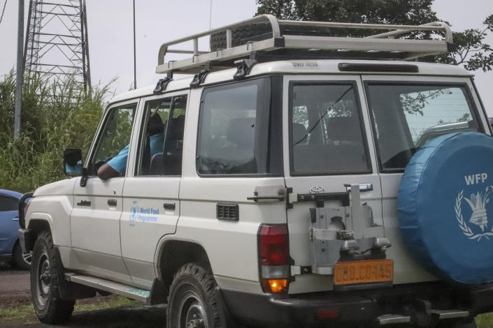 The vehicle in which the Italian ambassador to Congo was killed, according to those at the scene, sits with a smashed window in Nyiragongo, North Kivu province, Congo Monday, Feb. 22, 2021. The Italian ambassador to Congo Luca Attanasio, an Italian carabineri police officer and their Congolese driver were killed Monday in an attack on a U.N. convoy in an area that is home to myriad rebel groups, the Foreign Ministry and local people said. (AP Photo/Justin Kabumba)