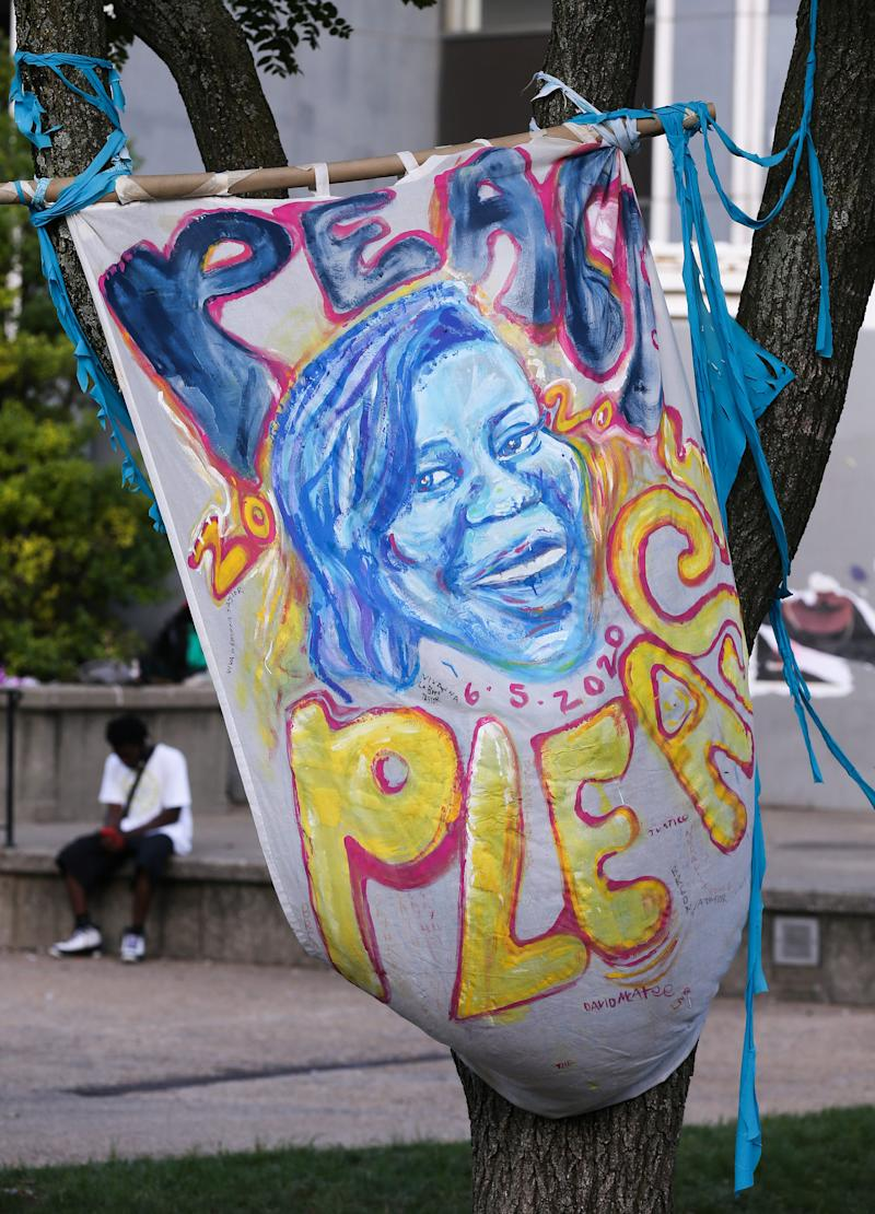 Artwork of Breonna Taylor hangs in Jefferson Square Park on Aug. 5 2020 to honor the slain 26-year-old who died at the hands of LMPD as they issued a no-knock warrant at her apartment.
