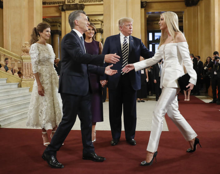 Argentina's President Mauricio Macri greets Ivanka Trump, the daughter and assistant to President Donald Trump, far right, as Juliana Awada, Macri's wife, first lady Melania Trump and President Donald Trump, looks on at the Teatro Colon for the G20 leaders dinner, Friday, Nov. 30, 2018 in Buenos Aires, Argentina. (Photo: Pablo Martinez Monsivais/AP)