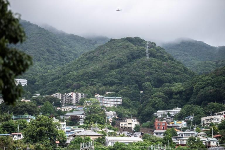 Scientists say climate change is intensifying Japan's rainy season because a warmer atmosphere holds more water