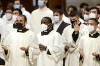 Prelates, wearing face masks to curb the spread of COVID-19, attend a ceremony led by Pope Francis to ordain nine new priests, inside St. Peter's Basilica, at the Vatican, Sunday, April 25, 2021. (AP Photo/Andrew Medichini)