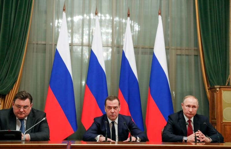Russian President Putin and Prime Minister Medvedev attend a meeting with members of the government in Moscow