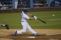Los Angeles Dodgers' Austin Barnes hits a two-run home run during the fourth inning of a baseball game against the San Diego Padres, Thursday, Aug. 13, 2020, in Los Angeles. (AP Photo/Jae C. Hong)