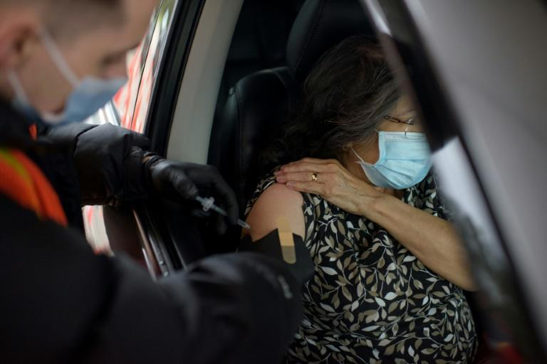 A woman receives her Covid-19 vaccine at a vaccination hub location in League City, Texas, February 5, 2021