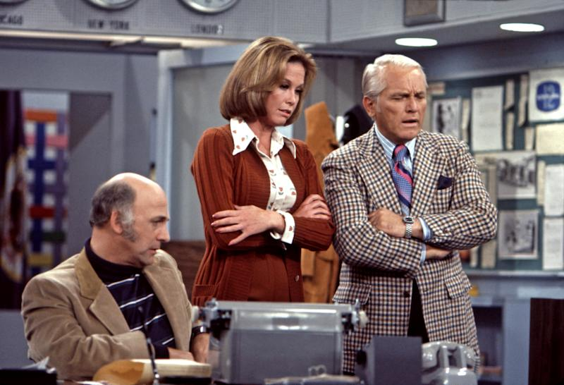 Gavin MacLeod, Mary Tyler Moore and Ted Knight rehearse scene from the Mary Tyler Moore Show, Sound Stage 2, CBS Studios, Los Angeles, 1974. 1970-1977. Photo: John G. Zimmerman Archive/Courtesy of Everett Collection. | John G. Zimmerman Archive/Courtesy Everett Collection—John G. Zimmerman Archive/Courtesy Everett Collection