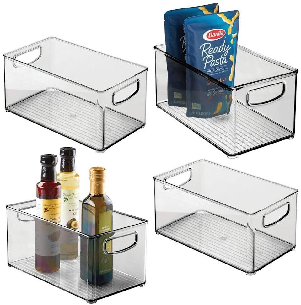 "<h2>mDesign Plastic Stackable Kitchen Bins</h2><br>This set of four will make life easier, meal prepping quicker, and finding that special sauce a little more effortless. <br><br><strong>mDesign</strong> mDesign Plastic Stackable Kitchen Bins, $, available at <a href=""https://www.amazon.com/mDesign-Plastic-Stackable-Refrigerator-Container/dp/B07KYWQVM7"" rel=""nofollow noopener"" target=""_blank"" data-ylk=""slk:Amazon"" class=""link rapid-noclick-resp"">Amazon</a>"