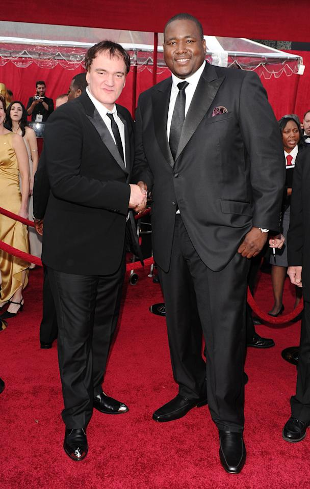 Quentin Tarantino and Quinton Aaron arrive at the 82nd Annual Academy Awards held at Kodak Theatre on March 7, 2010 in Hollywood, California.