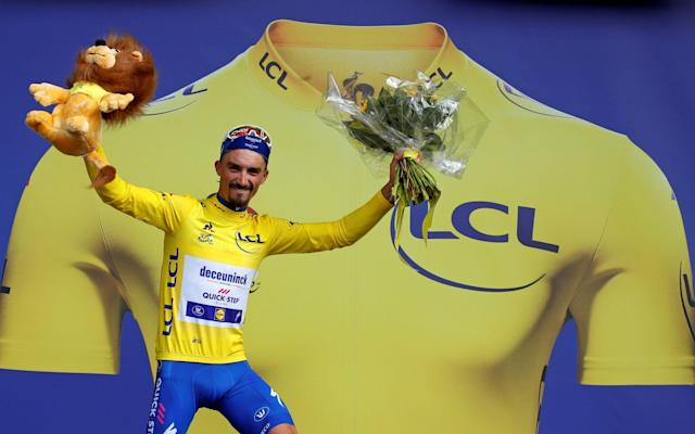 Julian Alaphilippe's becomes the first Frenchman since 2014 to wear the yellow jersey  - REUTERS