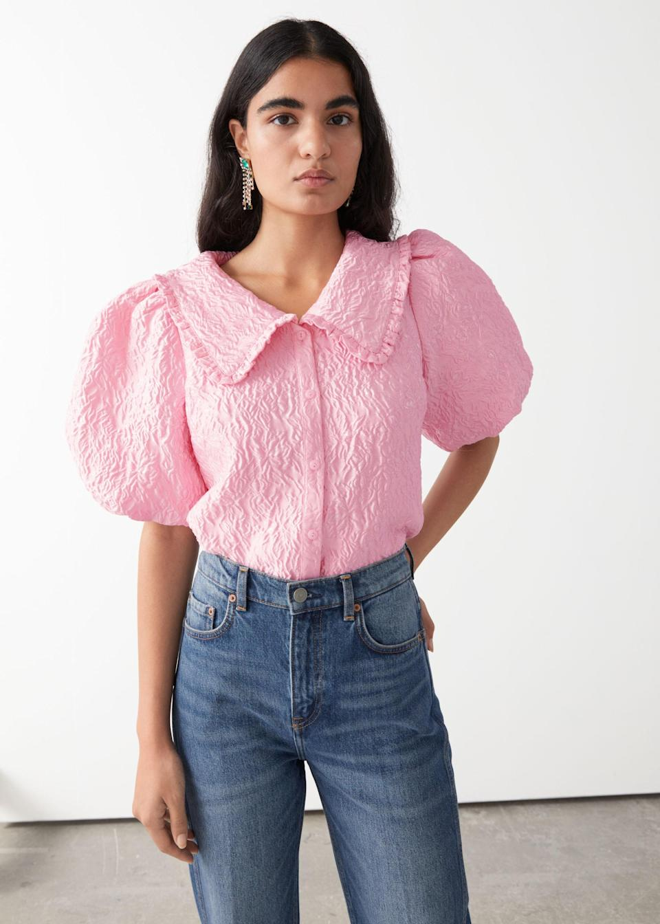"""A pop of pink never hurt anyone, no matter the season, and we're always here for a puff-sleeve moment. $69, & Other Stories. <a href=""""https://www.stories.com/en_usd/clothing/blouses-shirts/blouses/product.textured-ruffle-collar-puff-sleeve-top-pink.0883661001.html"""" rel=""""nofollow noopener"""" target=""""_blank"""" data-ylk=""""slk:Get it now!"""" class=""""link rapid-noclick-resp"""">Get it now!</a>"""