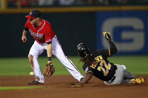 Pittsburgh Pirates' Andrew McCutchen (22) steals second as Atlanta Braves shortstop Tyler Pastornicky handles the late throw in the fourth inning of a baseball game on Friday, April 27, 2012, in Atlanta. (AP Photo/John Bazemore)