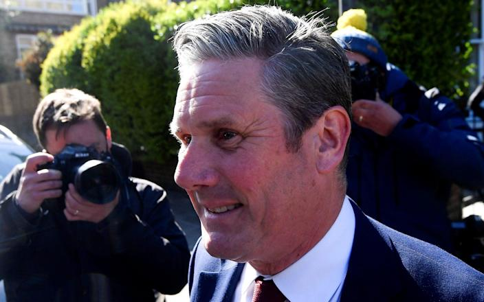 Sir Keir Starmer forces a grin as he leaves his London home this morning - Reuters