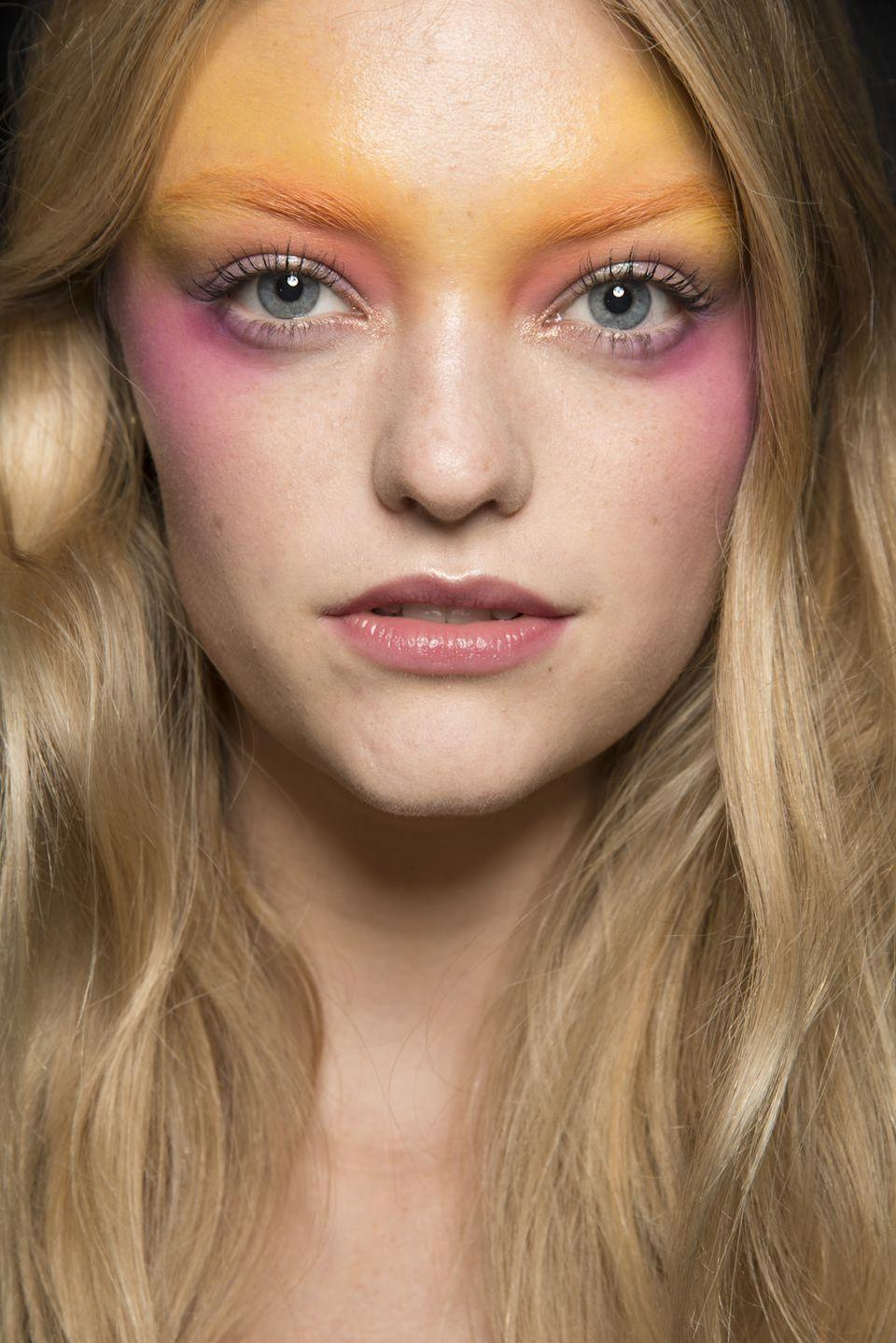 <p>An orange and pink flush carried over the cheeks, eyes, and brows backstage at Anna Sui.</p>