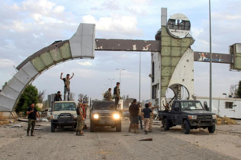 Fighters loyal to the UN-recognized Libyan Government of National Accord recapture Tripoli International Airport after clashes with strongman Khalifa Haftar (AFP Photo/-)