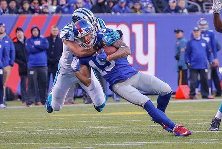 Dec 20, 2015; East Rutherford, NJ, USA; Carolina Panthers free safety Kurt Coleman (20) tackles New York Giants wide receiver Myles White (19) during the third quarter at MetLife Stadium. Mandatory Credit: Jim O'Connor-USA TODAY Sports