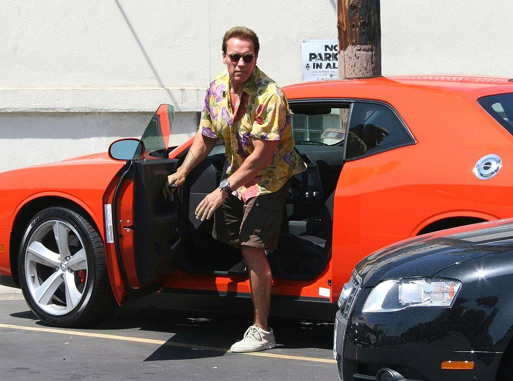 "Arnold Schwarzenegger obviously doesn't need to worry about the price of oil. The Terminator's outrageous orange Dodge Challenger SRT8 is gorgeous despite being a gas guzzler. Richard Harding/<a href=""http://www.pacificcoastnews.com/"" target=""new"">PacificCoastNews.com</a> - June 29, 2008"