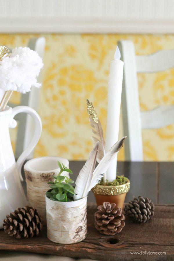 """<p>A mini gold moose, succulents, pinecones, and DIY glittered pots create an eclectic arrangement on this Thanksgiving table.</p><p><strong><strong>Get the tutorial</strong> at <a href=""""http://lollyjane.com/easy-fall-tablescape-ideas/"""" rel=""""nofollow noopener"""" target=""""_blank"""" data-ylk=""""slk:Lolly Jane"""" class=""""link rapid-noclick-resp"""">Lolly Jane</a>.</strong></p><p><a class=""""link rapid-noclick-resp"""" href=""""https://www.amazon.com/SuperMoss-24511-Black-Spruce-8-Ounce/dp/B00K80EWGA/?tag=syn-yahoo-20&ascsubtag=%5Bartid%7C10050.g.2130%5Bsrc%7Cyahoo-us"""" rel=""""nofollow noopener"""" target=""""_blank"""" data-ylk=""""slk:SHOP PINE CONES""""><strong>SHOP PINE CONES</strong></a> </p>"""
