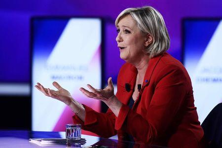 "Marine Le Pen, French National Front (FN) political party leader and candidate for French 2017 presidential election, attends the France 2 television special prime time political show, ""15min to Convince"" in Saint-Cloud, near Paris, France, April 20, 2017. REUTERS/Martin Bureau/Pool"