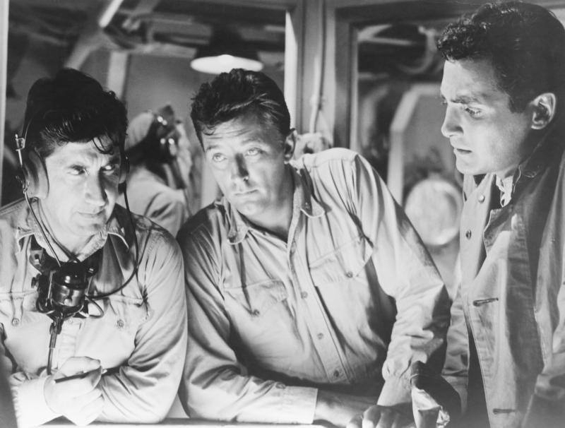 Actors David Post (L), Robert Mitchum (C), and David Hedison(R) in a submarine scene from the 1957 World War II film The Enemy Below. Post plays a sonar operator, Mitchum plays the role of Captain Murrell, and Hedison plays the role of Lt. Ware. (Photo by �� John Springer Collection/CORBIS/Corbis via Getty Images)