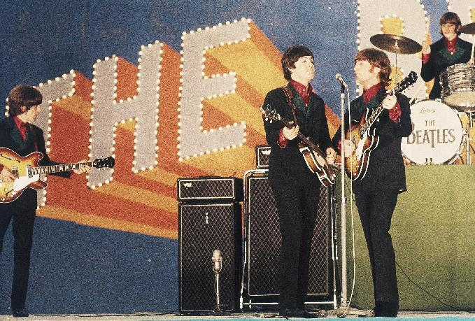 FILE - In this June 30, 1966 file photo, the Beatles perform at Budokan Hall in Tokyo for the first time. From left: George Harrison, Paul McCartney, John Lennon and Ringo Starr. McCartney turned 70 years of age Monday June 18, 2012. (AP Photo/File)