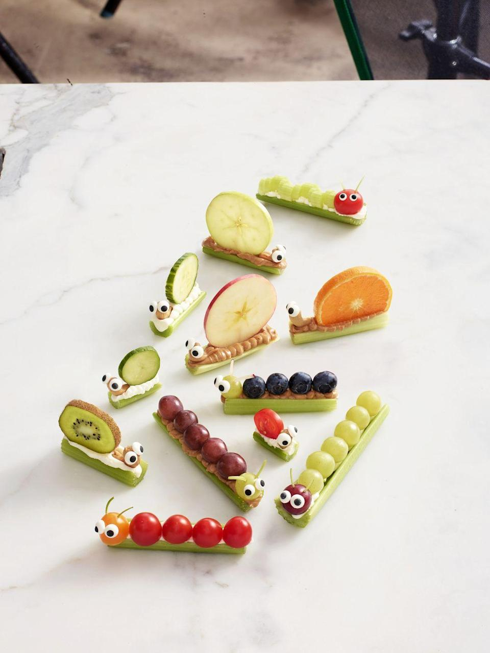 """<p>These adorable snacks take ants on a log to the next level.</p><p><a href=""""https://www.womansday.com/food-recipes/food-drinks/recipes/a55811/celery-snails-caterpillars-recipe/"""" rel=""""nofollow noopener"""" target=""""_blank"""" data-ylk=""""slk:Get the Celery Snails & Caterpillars recipe."""" class=""""link rapid-noclick-resp""""><u><u><em>Get the Celery Snails & Caterpillars recipe.</em></u></u></a></p>"""