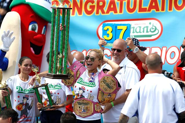 <p>Miki Sudo celebrates her victory in the 2018 Nathan's Famous International Hot Dog Eating Contest at Coney Island in the Brooklyn borough of New York City, United States on July 4, 2018. (Photo: Atilgan Ozdil/Anadolu Agency/Getty Images) </p>