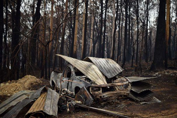PHOTO: A charred vehicle gutted by bush fires in Mogo Village in Australia's New South Wales state, sits among the burned debris, Jan. 6, 2020. (Saeed Khan/AFP via Getty Images)
