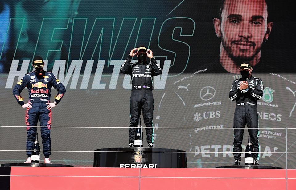 Second placed Max Verstappen (pictured left), race winner Lewis Hamilton (pictured middle) and third placed Valtteri Bottas (pictured right) stand on the podium after the F1 Grand Prix of Portugal at Autodromo Internacional Do Algarve on May 02, 2021 in Portimao, Portugal.