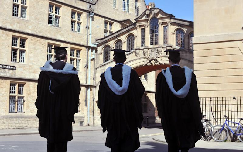 Graduates in traditional robes at Oxford University - Getty Images Contributor