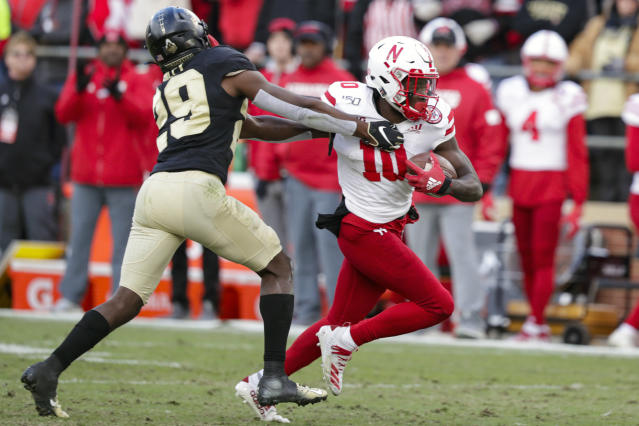 FILE - In this Nov. 2, 2019, file photo, Nebraska wide receiver JD Spielman (10) holds off Purdue cornerback Simeon Smiley (29) during the second half of an NCAA college football game in West Lafayette, Ind. Spielman, one of the top receivers in Nebraska history, has entered his name in the transfer portal, the school confirmed Monday, June 8, 2020. Spielman is the first player to put together three straight 800-yard receiving seasons for the Cornhuskers and leaves No. 3 in career receptions and yards. (AP Photo/Michael Conroy, File)