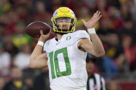 Oregon quarterback Justin Herbert throws a pass during the first half of an NCAA college football game against Southern California, Saturday, Nov. 2, 2019, in Los Angeles. (AP Photo/Kyusung Gong)