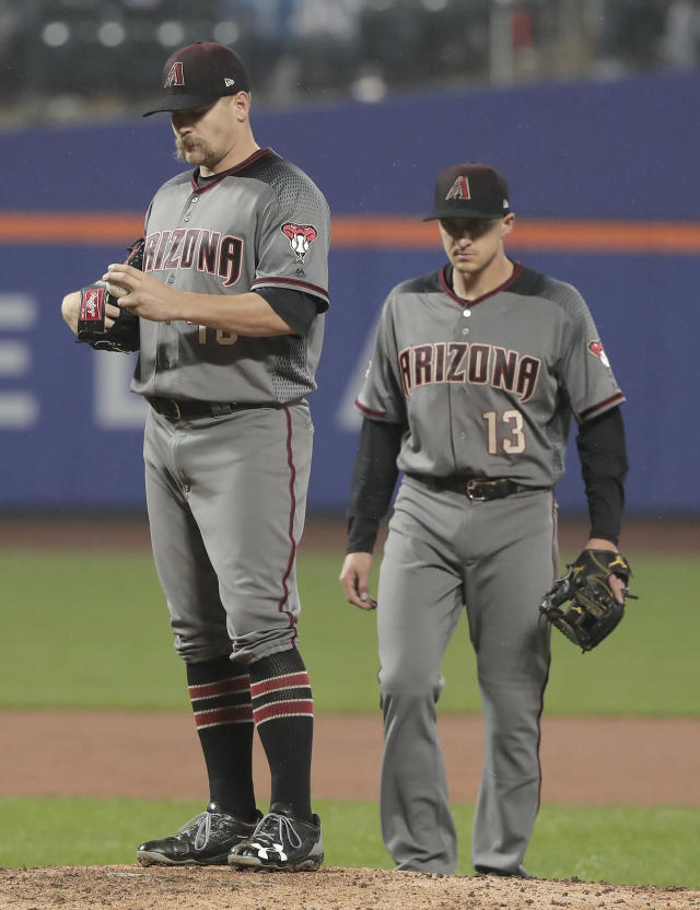 Arizona Diamondbacks shortstop Nick Ahmed (13) approaches pitcher Andrew Chafin (40) for a conference on the mound during the ninth inning of a baseball game against the New York Mets, Saturday, May 19, 2018, in New York. (AP Photo/Julie Jacobson)
