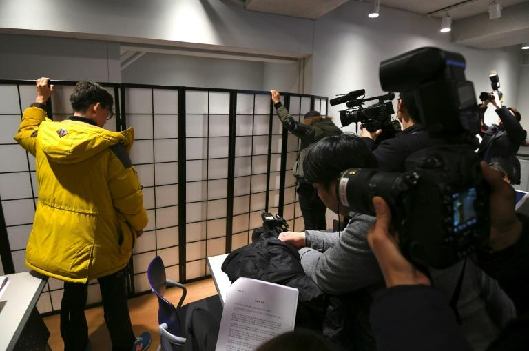 An anonymous South Korean actress speaks from behind a screen during a press conference accusing Kim of abusing her