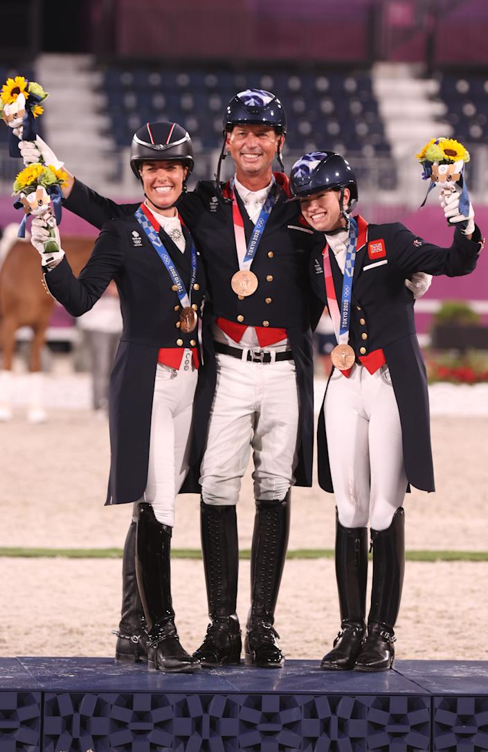 <p>TOKYO, JAPAN - JULY 27: Bronze medalist Charlotte Dujardin, Carl Hester and Charlotte Fry of Team Great Britain pose on the podium during the medal ceremony for the Dressage Team Grand Prix Special Team Final on day four of the Tokyo 2020 Olympic Games at Equestrian Park on July 27, 2021 in Tokyo, Japan. (Photo by Julian Finney/Getty Images)</p>