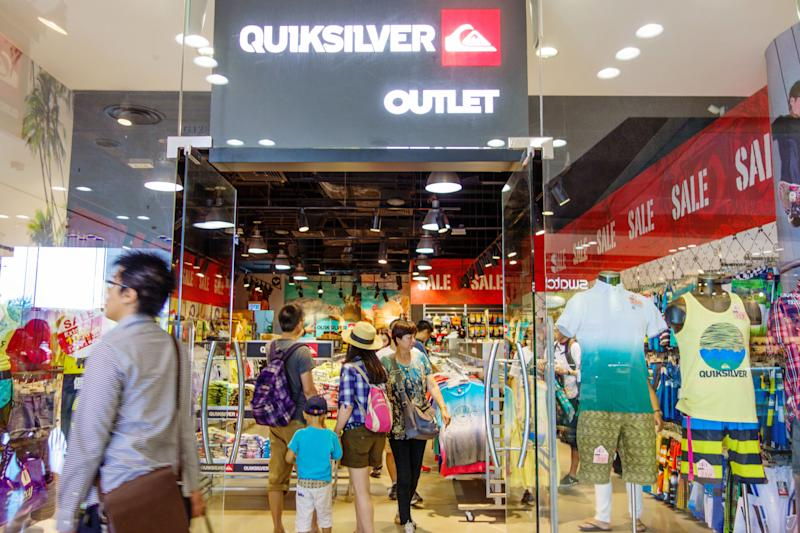 Customers shop at an outlet of Quiksilver in Hong Kong, China.