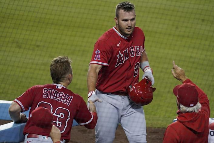 Angels' Mike Trout returns to the dugout after hitting a three-run home run against the Dodgers on Sept. 25.